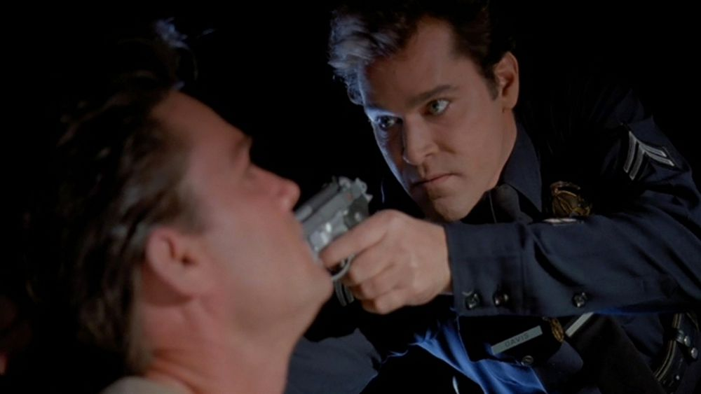 This image has an empty alt attribute; its file name is unlawful-entry-liotta-with-gun.jpg
