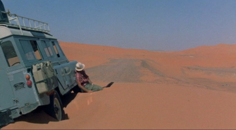 This image has an empty alt attribute; its file name is the-passanger-desert-car.jpg
