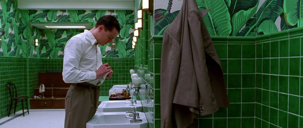 This image has an empty alt attribute; its file name is aviator-bathroom-scorsese-1024x435.jpg