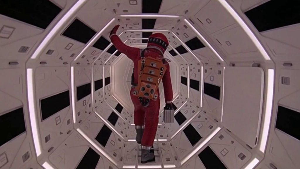 This image has an empty alt attribute; its file name is kubrick-2001-walking-down-hall-1024x576.jpg