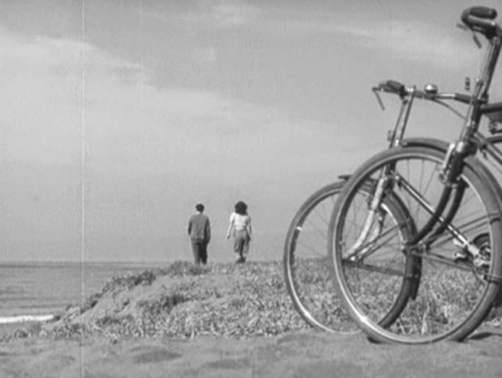This image has an empty alt attribute; its file name is ozu-late-spring-bikes.jpeg