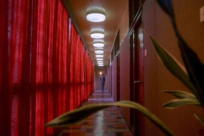 This image has an empty alt attribute; its file name is in-the-mood-for-love-red-hallway-stunner-wkw.jpg