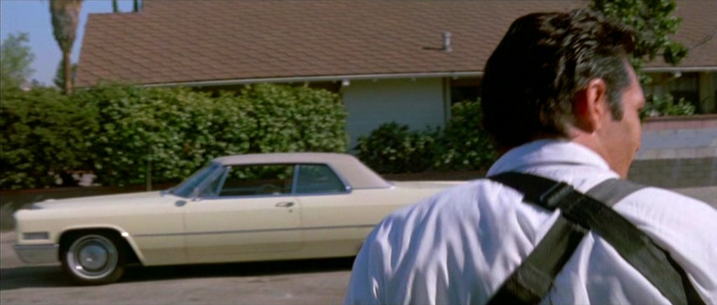 This image has an empty alt attribute; its file name is madsen-reservoir-dogs-going-to-car.jpg