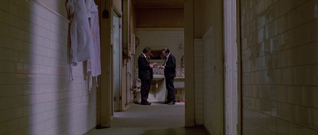 This image has an empty alt attribute; its file name is reservoir-dogs-tarantino-hallway-1024x435.jpg