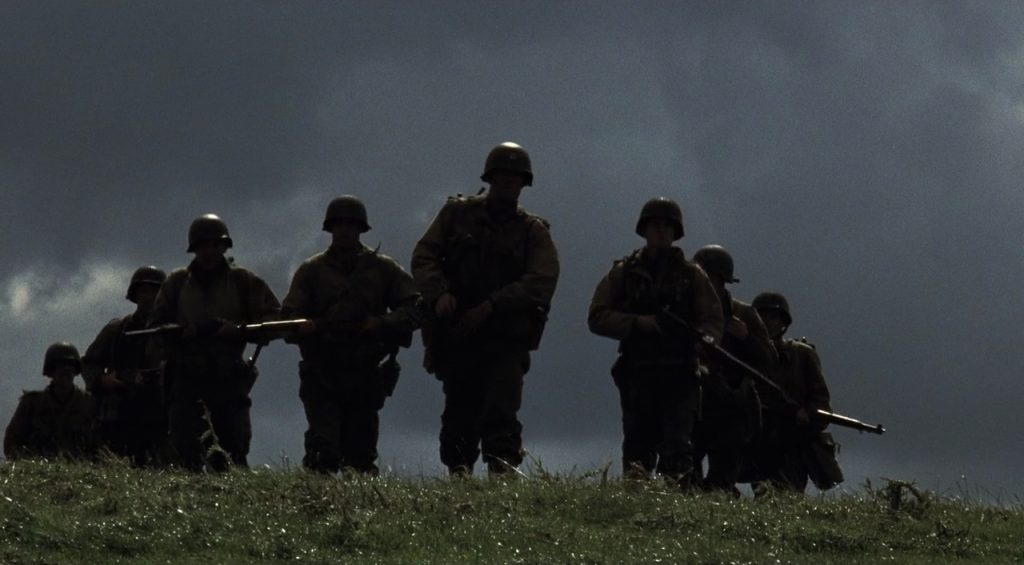 This image has an empty alt attribute; its file name is saving-private-ryan-spielberg-shadow-men-on-hill-1024x565.jpg